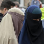Most Swiss in favour of federal vote to ban public face covering